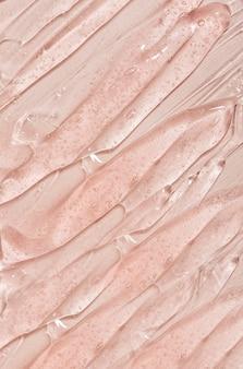 Textura de gel de sérum da beleza creme de cuidado de pele transparente com fundo de bolhas