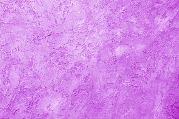 Textura de gesso rosa. parede áspera do prédio.