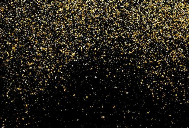 Textura de glitter dourado em fundo preto abstrato