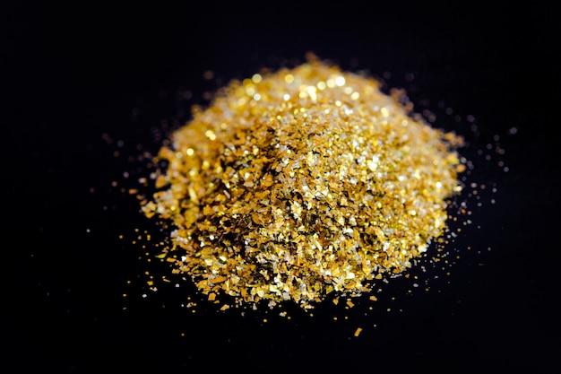 Textura de glitter dourado em preto abstrato