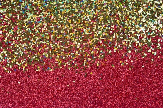 Textura de glitter, fundo vermelho e dourado brilhante