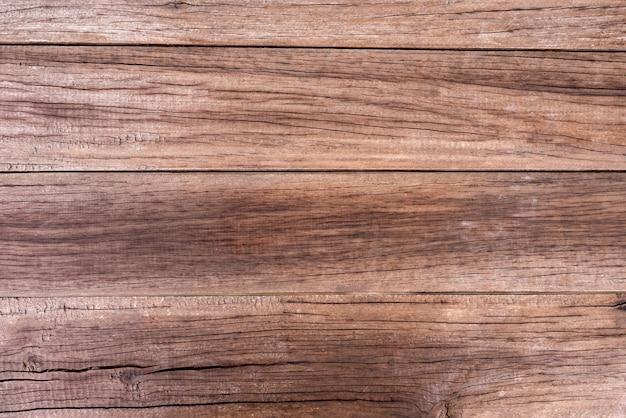 Textura de grão de madeira natural, marrom, rachada e velha.