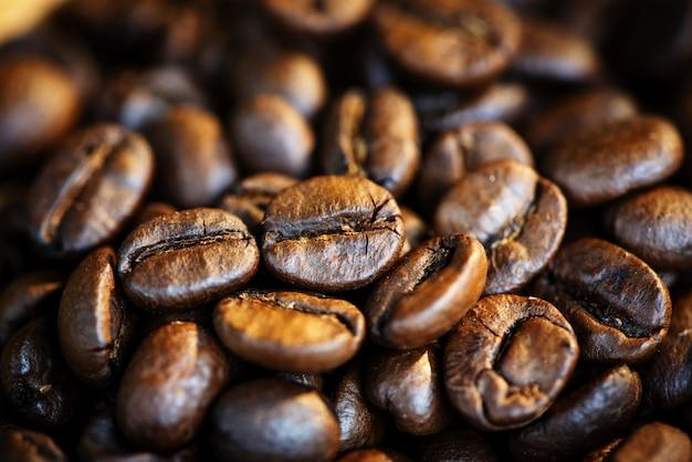 Textura de grãos de café torrado / grupo de macro closeup de grãos de café
