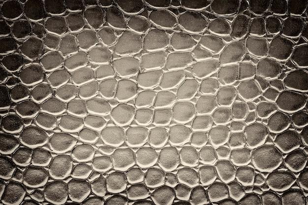Textura de imitação de couro de crocodilo ao fundo. preto e branco