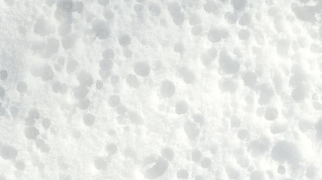 Textura de inverno, fundo de neve. padrões na neve. plano de fundo