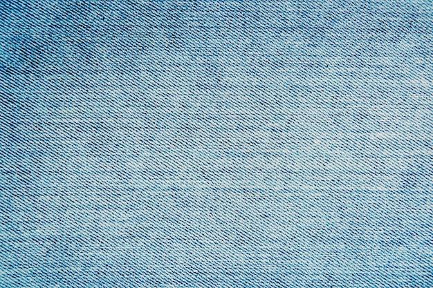 Textura de jeans azul, fundo de jeans, em branco