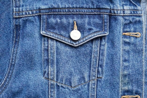 Textura de jeans clássico, close-up. jaqueta jeans azul, jeans.