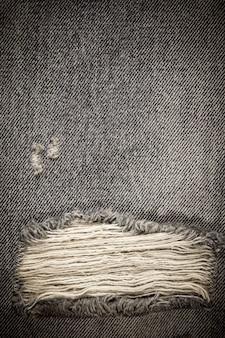 Textura de jeans jeans rasgado vintage.