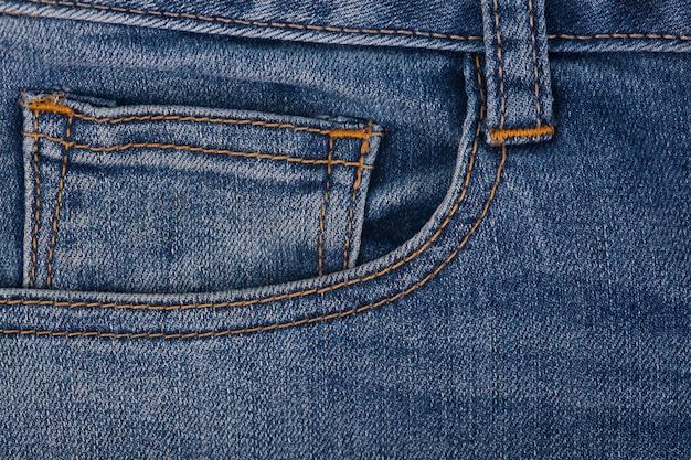 Textura de jeans. superfície azul denim criativo close-up