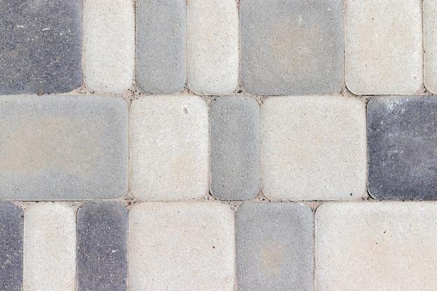 Textura de ladrilhos de concreto para exteriores em diferentes tons de cinza