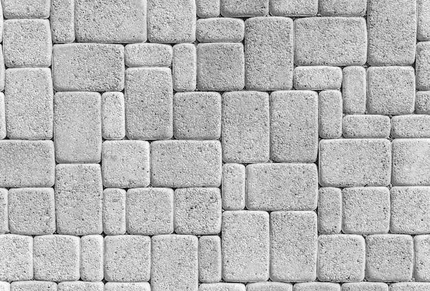 Textura de ladrilhos de pedra de mármore bege sem costura com linha de junção preta
