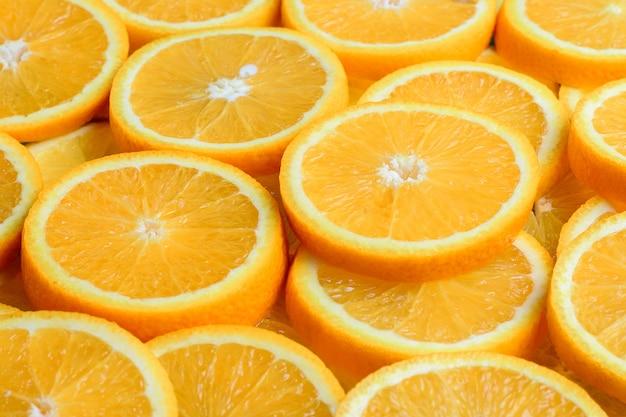 Textura de laranja fatiada, fruta fresca e saudável, que é rica em suco e vitamina c.