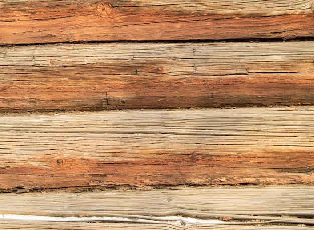 Textura de madeira antiga com padrões naturais de crack, fundo marrom Foto Premium