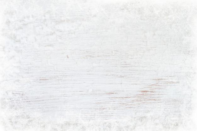 Textura de madeira branca velha com neve. vista superior, design de fronteira.