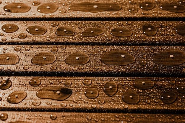 Textura de madeira com pingos de chuva com foco seletivo copiar espaço Foto Premium