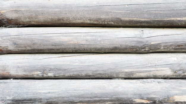 Textura de madeira como pano de fundo. vista superior da superfície da mesa para fotografar lay-out. molde abstrato em branco. galpão de madeira resistida rústico com nós e orifícios para pregos.