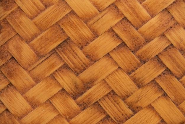 Textura de madeira de bambu velha e plano de fundo padrão.