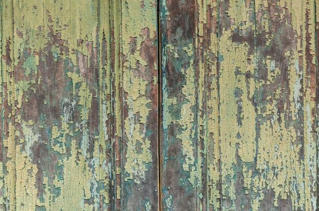 Textura de madeira de placas em tinta velha, fundo de textura de pranchas de madeira pastel.