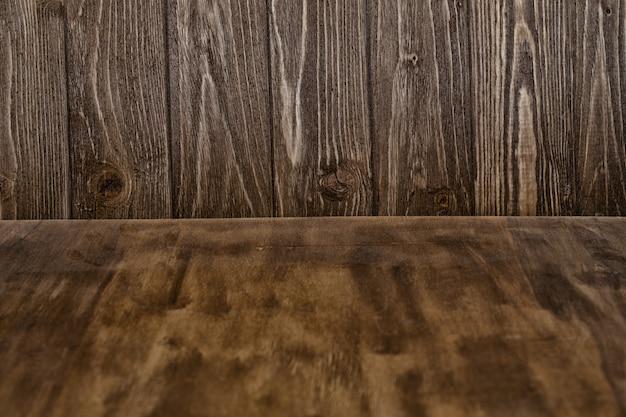 Textura de madeira desgastada como um forefront e placas de madeira como pano de fundo
