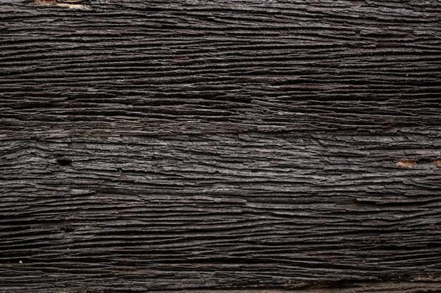 Textura de madeira escura de grunge velho vista superior