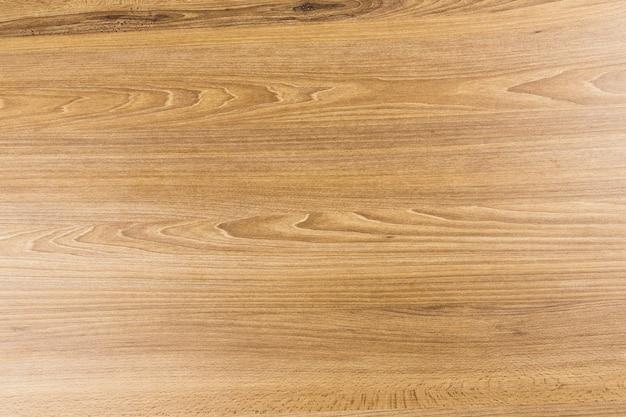 Textura de madeira. madeira rústica com algumas imperfeições. vista do topo.