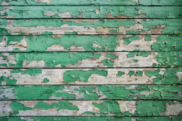 Textura de madeira pintada de verde da parede de madeira para plano de fundo e textura.