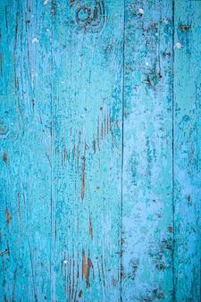 Textura de madeira, tábuas velhas com tinta azul descascada