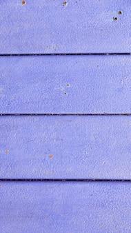 Textura de madeira vertical roxa. painéis antigos de fundo. abstrato, modelo vazio