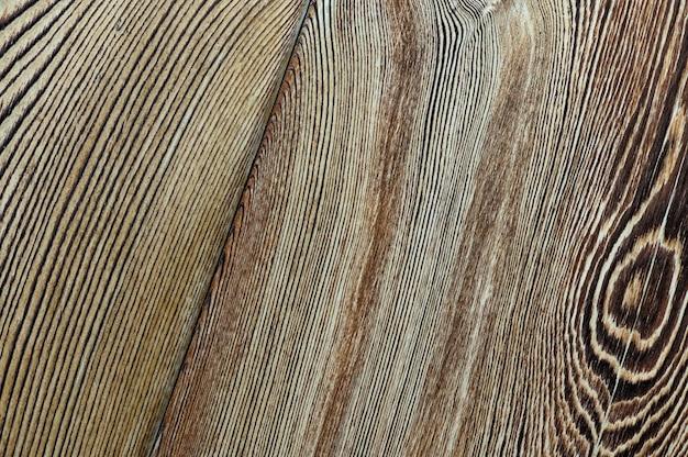 Textura de madeira vintage com vista superior do close up dos nós para o fundo