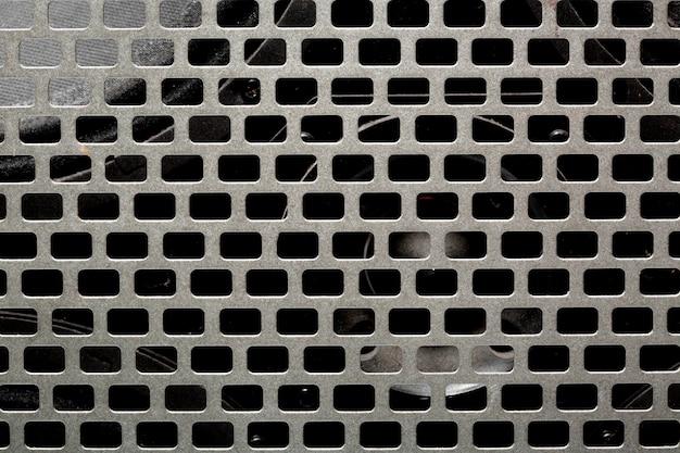 Textura de malha de aço do instrumento musical. alto-falante de áudio amplificador preto