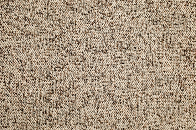 Textura de malha de lã de superfície marrom bege branco. fundo, papel de parede de fibras. tecido quente. foto de alta qualidade