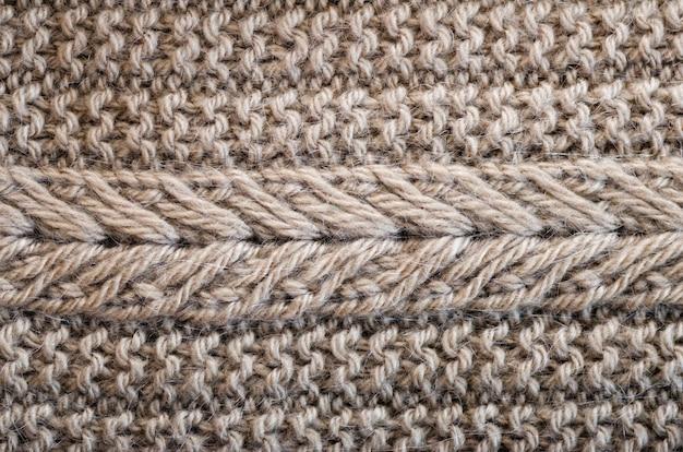 Textura de malha. tecido padrão feito de lã. fundo, espaço da cópia