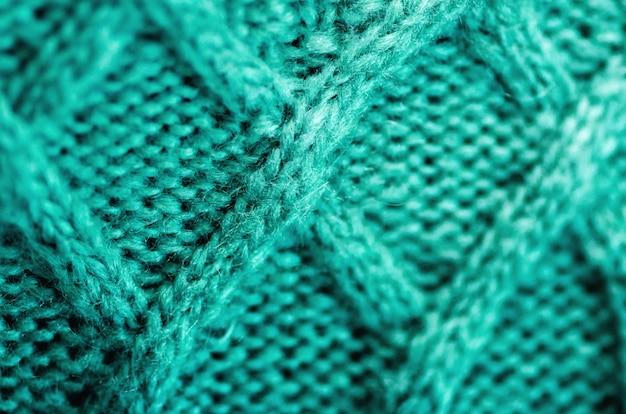 Textura de malha. tecido padrão feito de lã. fundo turquesa