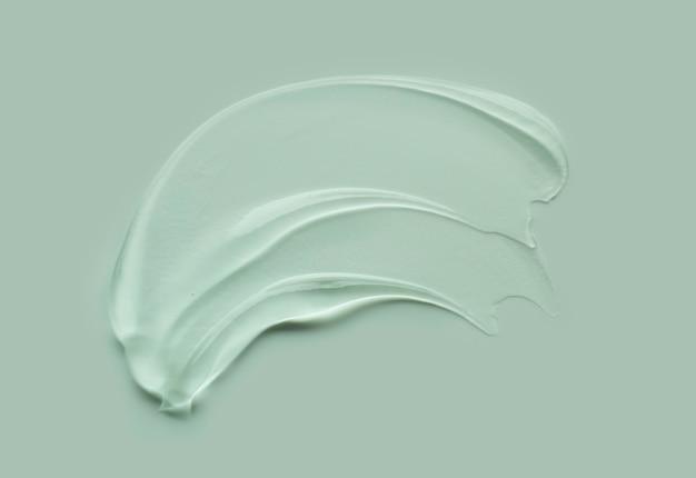 Textura de mancha cosmética de gel líquido em fundo de cor pastel