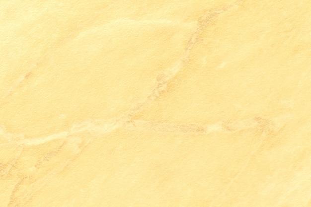 Textura de mármore amarelo claro com linhas douradas