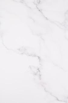 Textura de mármore branca com teste padrão natural para o trabalho de arte do fundo ou do projeto.