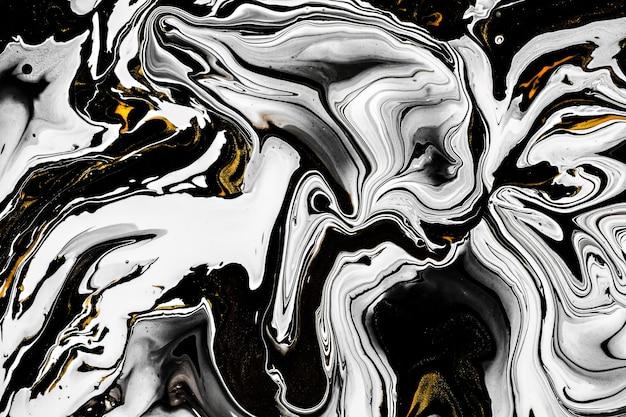 Textura de mármore preto e branco com lotes dourados de veios contrastantes em negrito aplicáveis para criar design de efeito de mármore de superfície para embalagem, folheto, pôster, papel de parede, decoração, têxtil