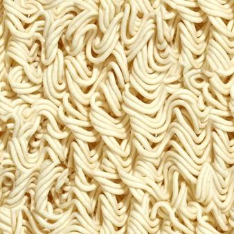 Textura de massa de macarrão tileable sem costura útil como pano de fundo