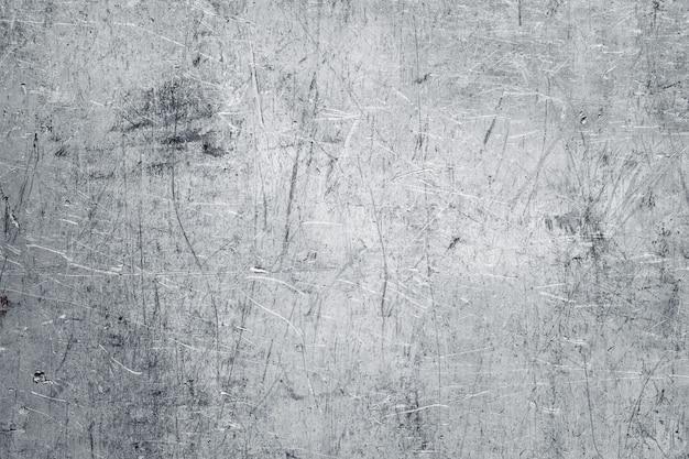 Textura de metal amassada, parede de aço inoxidável com danos mecânicos