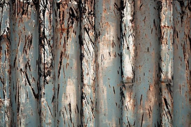 Textura de metal enferrujado com fundo de pintura descascada