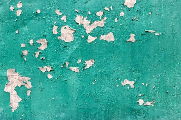 Textura de metal enferrujado com uma pintura velha de casca