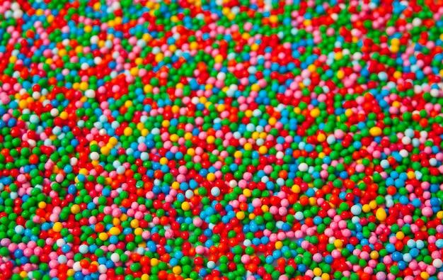 Textura de miçangas pequenas doces coloridos doces