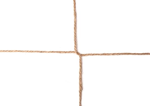 Textura de nó cruzado de fio isolada em fundo branco, foto macro