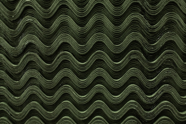 Textura de onda padrão de telhas de ardósia verde do telhado.