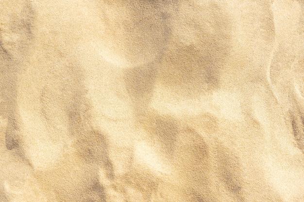 Textura de padrão de areia para o fundo. padrão de deserto marrom de praia tropical. fechar-se.