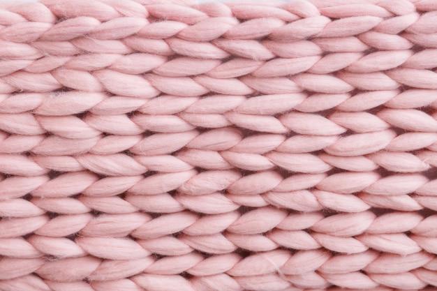 Textura de padrão de lã tricotada de lã merino rosa.