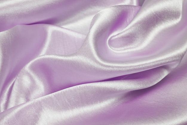 Textura de pano de luxo cetim roxo bonito pode usar como plano de fundo do casamento