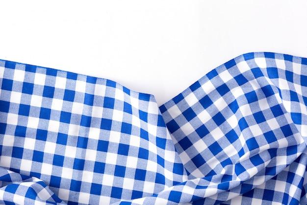 Textura de pano de mesa azul sobre fundo branco