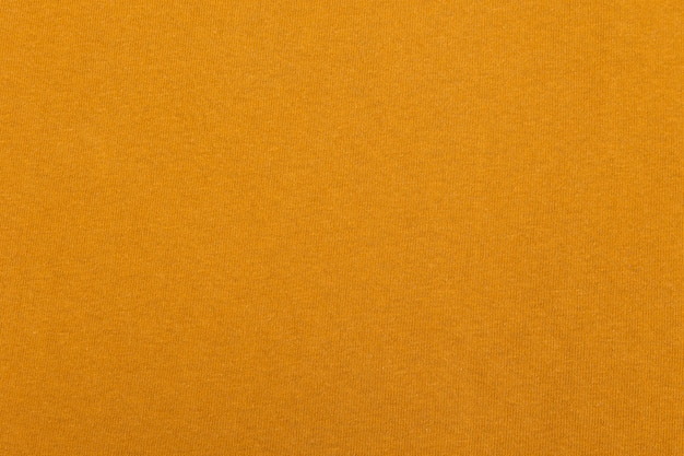 Textura de pano de tecido amarelo.