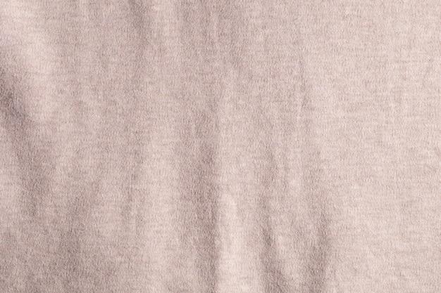 Textura de pano de tecido marrom e cinza e fundo de matéria têxtil.